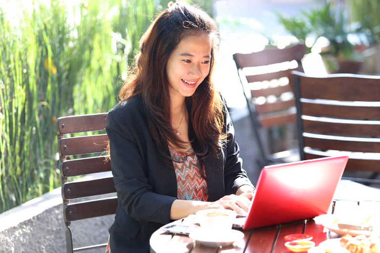 38304660 - a portrait of a young businesswoman work oudoor, in a cafe